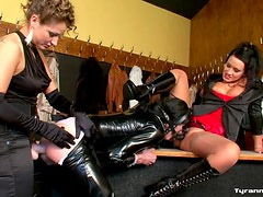 Sissy in latex fucked by strapons