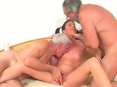 Perverted brunette with pigtails sucks one old dick and rides the other