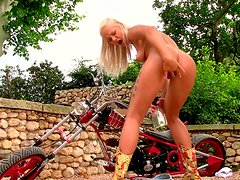 Sassy bike girl is undressing and fingering outdoor
