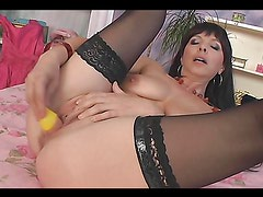 Whore sticks cock-shaped toy in her cunt!