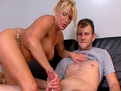 Blonde milf is jerking off a thick cock