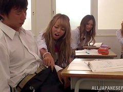 Hot Japanese chick give a handjob in front of the classmates