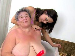 Granny is penetrating her lovely pussy