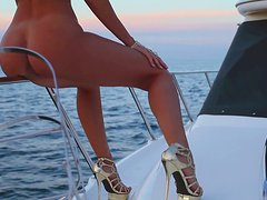 Jennifer Vaughn poses for the cam on a boat in Playboy backstage vid