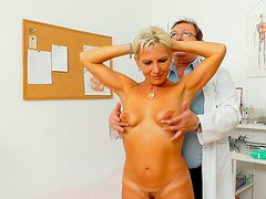 Gyno doctor examines pussy of one cougar blonde milf