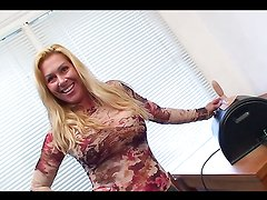 Busty blonde whore rides a Sybian Saddle!