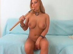 Super hot porn model with stunning body is masturbating with baseball bat while sucking lollipop