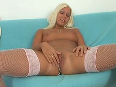 Playful blond cutie pounds her gaped vagina with huge dildo