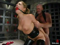 Smoking hot blondie is being penetrated with a ball gag on