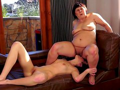 Fat granny is getting cuni by sexy young brunette