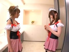 Two busty Japanese bitches enjoy playing with each other's tits