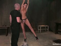 Naughty brunette gets nailed from behind in a BDSM