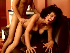 Brunette cougar is getting screwed hard in a doggy sex position