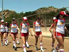 Female baseball team working out outdoor wearing sexy uniform