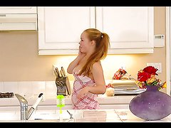 Cute Chick Fingers Her Pussy on the Kitchen Counter