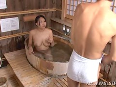Japanese bitch blows and gets fucked from behind in a sauna