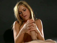 Appealing blonde whore gives her lover a nice handjob
