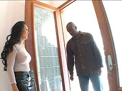 Buxom horny Asian in fishnet top sucks the BBC of her horny black neighbor