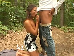 Naughty girl with perky tits is sucking cock outdoor