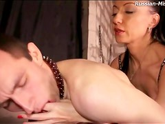Strapon cock fucks asshole of submissive guy
