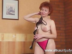 Redheaded GILF Julia fingers her shaved wet pussy
