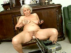 Perverted granny is fucked with sex machine while sucking black cock