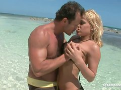 Big tittied Britney gets fucked nice and deep on a beach