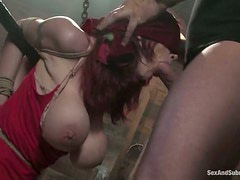 Slender redhead gets chained up and tortured so hard