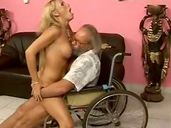 Raunchy whore Vivan is riding dick of old grandpa in wheels