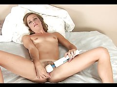 Blonde milf finds pleasure in playing with her toys