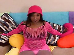 Voluptuous ebony oils up her huge knockers & gives tit job