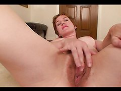 Sexy babe plays with her hairy pussy