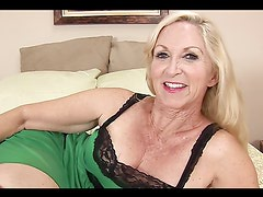 Blonde whore gets naked on bed and fingers herself