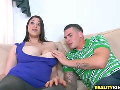 Big tittied Angel Deluca rides a dick lying on a sofa