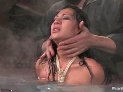Curvy brunette gets tied up and sprayed with water