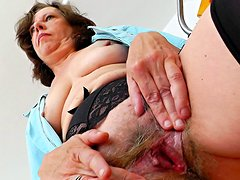 Old nurse bangs her hairy pussy on the stretcher