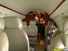 Two sexy stewardesses get pounded right in a plane