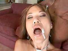 Busty light haired Asian nympho is fucked missionary and gets cumshot on face