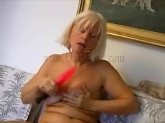 Blonde granny masturbates with red dildo