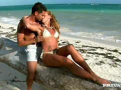 Kathy Campbel gives a terrific blowjob on the shore of a sea