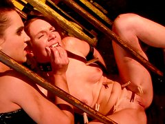 Wicked mistress clamps clothespins on her slave's tongue and tits