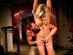 Horn-mad stud stimulates tied up blondie's slit with clitoral vibrator