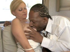 Busty pale blondie provides a black stud with a handjob and dick riding