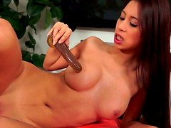 Alluring long haired Asian hottie hops on dildo with her fresh pussy