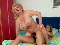 Horny brunette wears strapon and kinky oldie with huge ass rides it madly