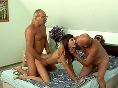 Sizzling brunette MILF stands doggy getting both her mouth and pussy fucked