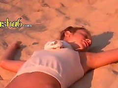 sexy babysitter posing on the hot beach