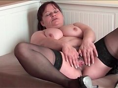 Old lady in stockings masturbates hairy pussy