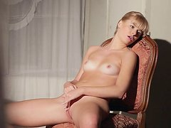 Blonde poses and masturbates on the chair