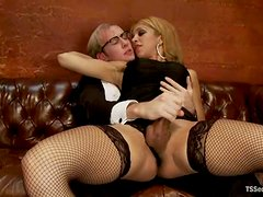 Blonde tranny in fishnets fucks a guy and gives a handjob